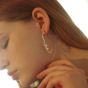 Minimalist gold line face silhouette earrings